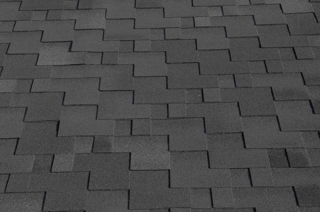 Dark shingles background above Glendale Roofing